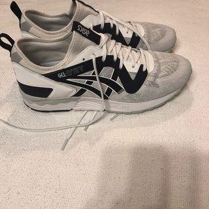 Men's ASICS tennis shoe.  Like new.